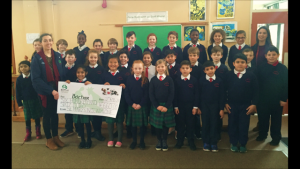 Bóthar representative Deirdre Mullins receiving the cheque of €660 raised by pupils of St. Mary's N.S.